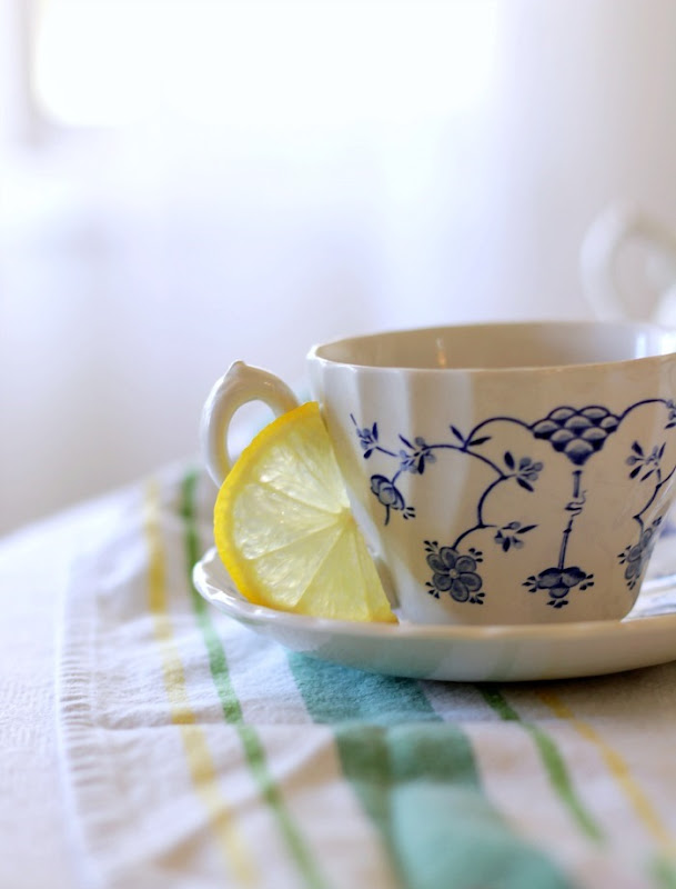 Teacup with Lemon Wedge