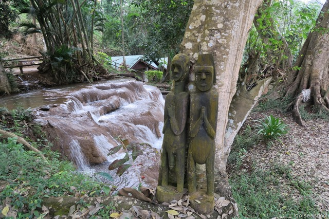 A pair of statues placed at the entrance to the hill-tribe village as a protection against evil spirits.