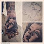 retrato bebê na mão tatuagem.jpg