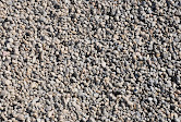 Pea Gravel - Small rounded pieces of rock the size of a pea. Can be used in dry creek beds, dog runs, or as a decorative landscaping rock.