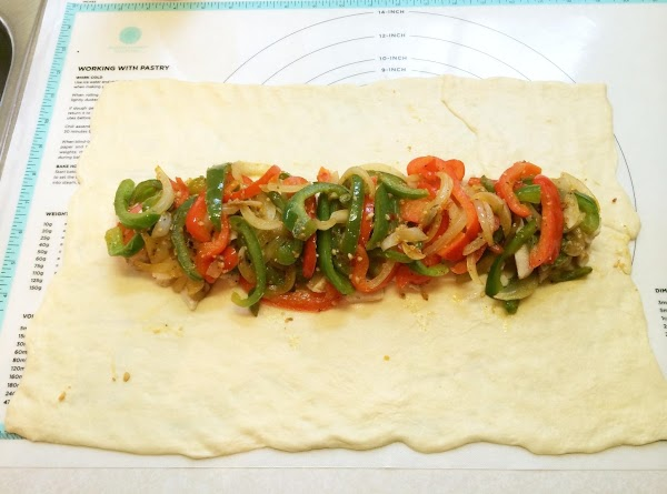 Spoon chicken mixture in 4-inch strip lengthwise down center of dough.