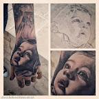 baby portrait in hand tattoo - tattoo designs