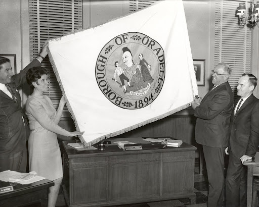 Flag, designed by Lydia Miniter, being presented to Mayor Wendel, Borough Hall, 1968
