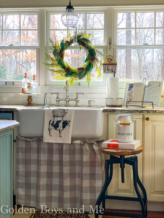 Farmhouse sink in cottage style kitchen with DIY sink skirt - www.goldenboysandme.com