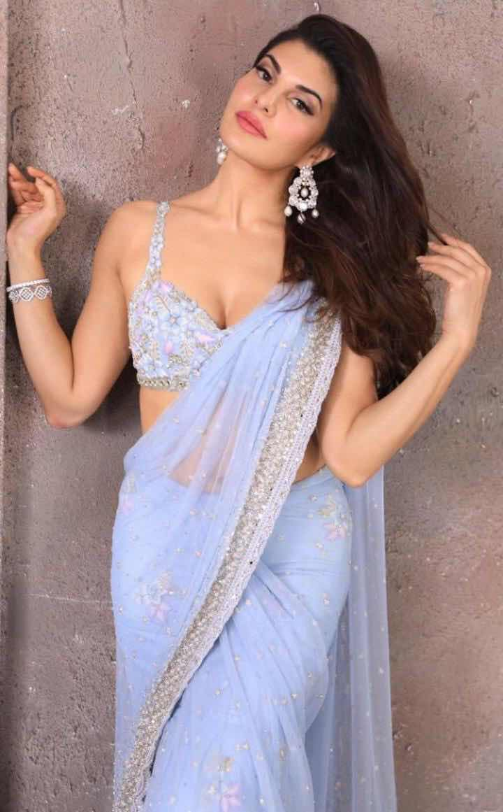 Jacqueline Fernandez Stills in South Indian Traditional Transparent Blue Saree and sleeveless blouse - Bollywood Hollywood South Indian Actress Gallery Navel Queens