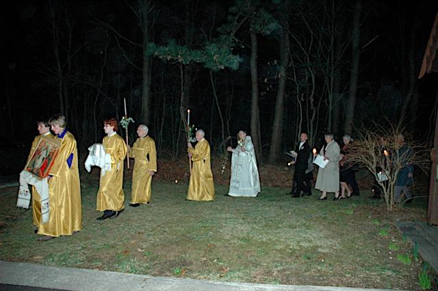 Clergy and faithful process around the church