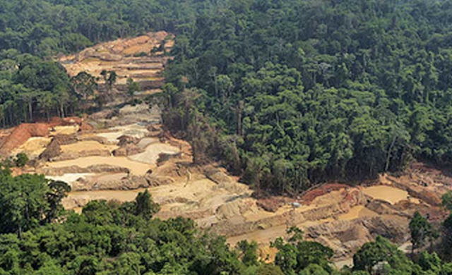 Aerial view of an illegal gold mine in Brazil, showing the scope of the extensive environmental destruction along the Tropas River. These gold mines, dug with heavy equipment, heavily pollute the river with runoff sediments, and also with mercury, used to purify the gold. The indigenous Munduruku rely on the river for drinking water and for fishing. Photo: Federal Police of Santarem