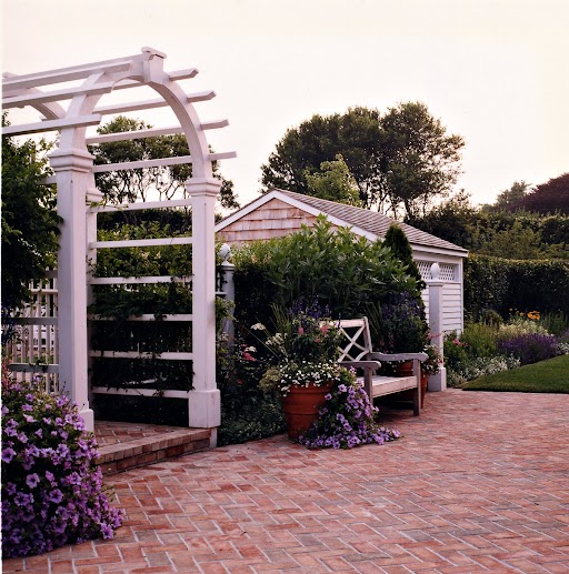 An arbor frames the pool entrance.
