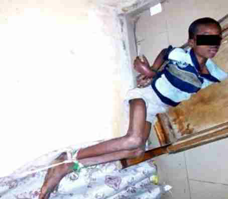 (Photo)Father burns son with iron, ties him to window after church leader said he was a wizard