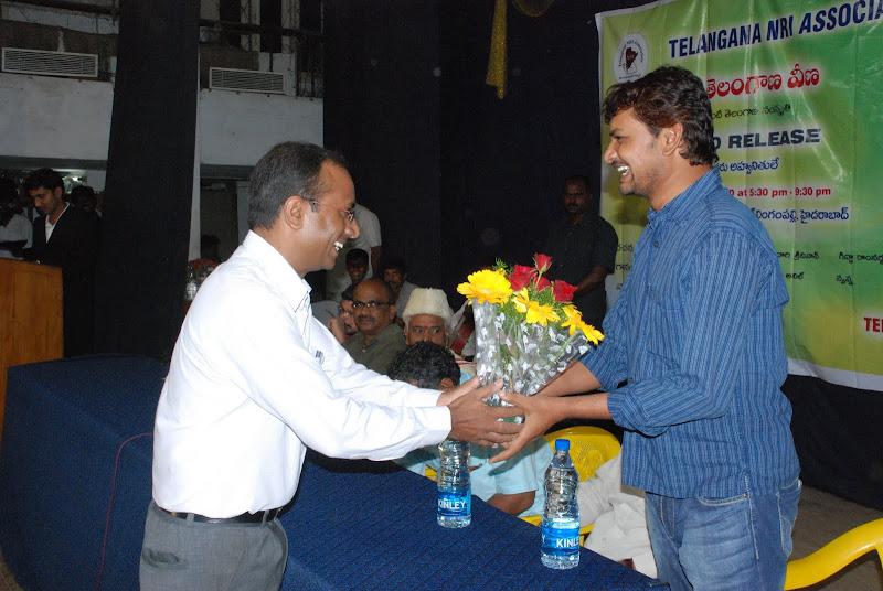 TeNA India coordinator Harikrishan presenting bouquet to Kodari Srinivas