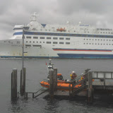 18 September 2011 - with all 4 crew members back aboard, the ILB prepares to set off back to station. The Barfleur ferry is departing Poole in the background, showing how busy the harbour's entrance can be.