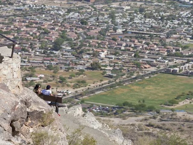 South Mountain Park in Phoenix is the largest municipal park in the United States at nearly 17,000 acres. Zahira Ortega and Daniel Garcia, both of Avondale, enjoy the panoramic view of the Valley from Dobbins Lookout. Photo: Cheryl Evans / The Republic
