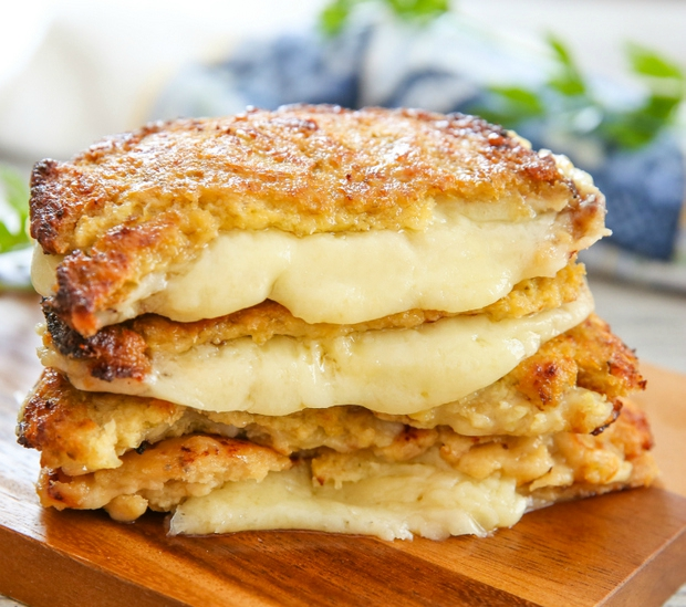 photo of a stack of three Cauliflower Crusted Grilled Cheese Sandwiches