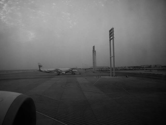 Dammam Airport, KSA through the dirty window of the Emirates Boeing 777-300 ER for the Dammam-Dubai connection