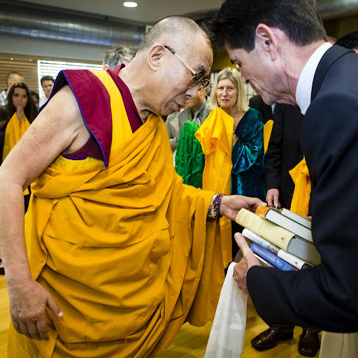 His Holiness being offered books by Tim McNeill, director of Wisdom Publications, at FPMT International Office, Portland, Oregon, U.S., May 10, 2013. Photo by Lean Nash.