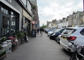 17050803 May 22 Looking down street while shopping in ST Andrews