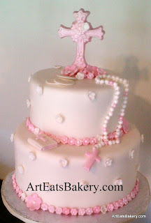 Girl's custom fondant first communion cake with edible pink cross, flowers, Bible and pearl rosary