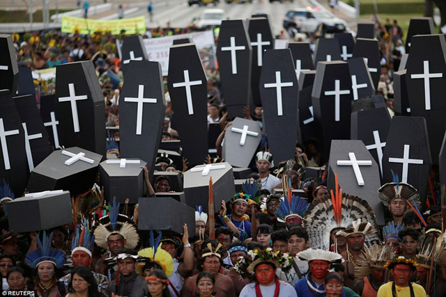 Indigenous Brazilian tribe protests Brasilia for greater rights, 25 April 2017. The tribal people are carrying coffins representing the indigenous dead from 305 ethnic groups who have died over the years in the take over of their ancestral lands. Photo: Reuters