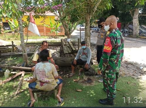 Sinergitas Babinsa Bersama Bhabinkamtibmas Dalam Memutus  Penyebaran Covid-19 di Wilayah Binaan