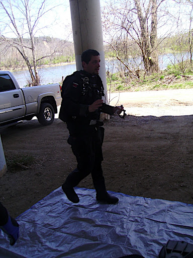 Scott in his dry suit walking on our clean tarp.