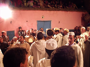 Photo: It happened that there was a wedding in the village the night we were staying there, so we were able to watch some of the celebrations, after the bride and groom had left. About half the men were dancing in a circle and singing, while the women, children and the rest of the men watched. Many of the women and children were on the rooftop; you can see a few of them at the top of this photo.
