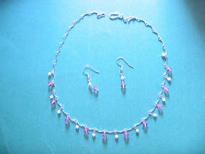 pink swarovski in wave chain $ 10.00