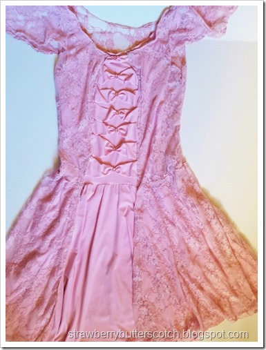 The sides of the bodice are sewn, the bodice has been cut down the center to open up as with the skirt, and the skirt is sewn to the bodice.  Plus, the lace over dress is layered over the old pink dress.