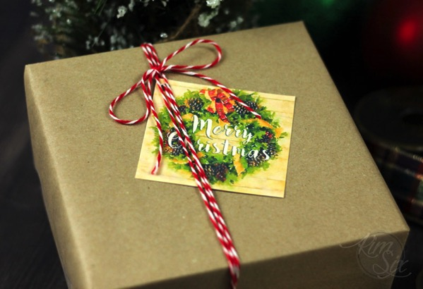 Merry Christmas gift tag on brown paper package