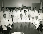 Louis Weinstein (front row, center) and his infectious diseases team, circa 1962. Dr. Phillip Lerner is immediately to the left of Weinstein. <br /> - - - -<br /> Phillip is the subject of his son Barron Lerner&#039;s book The Good Doctor: A Father, a Son, and the Evolution of Medical Ethics (2014, Beacon Press).