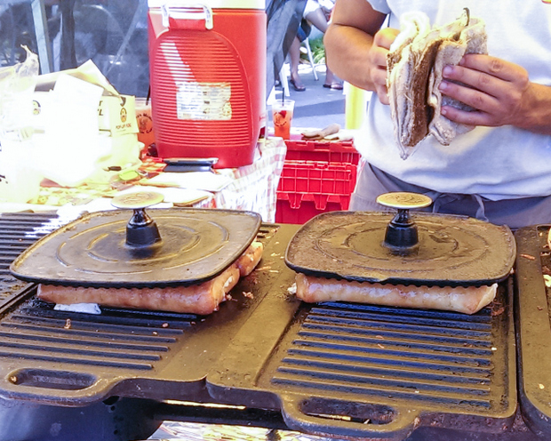 photo of paninis with sandwich presses on them