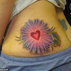 heart on a flower - Heart Tattoos