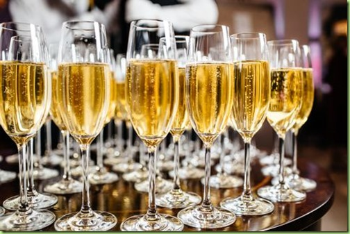 elegant-glasses-with-champagne-standing-in-a-row-on-royalty-free-image-868336554-1537971833