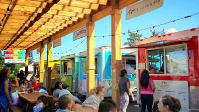 Portland Mercado and the colorful 8 carts of the food cart pod, where each food cart specializes in different Latin cuisine