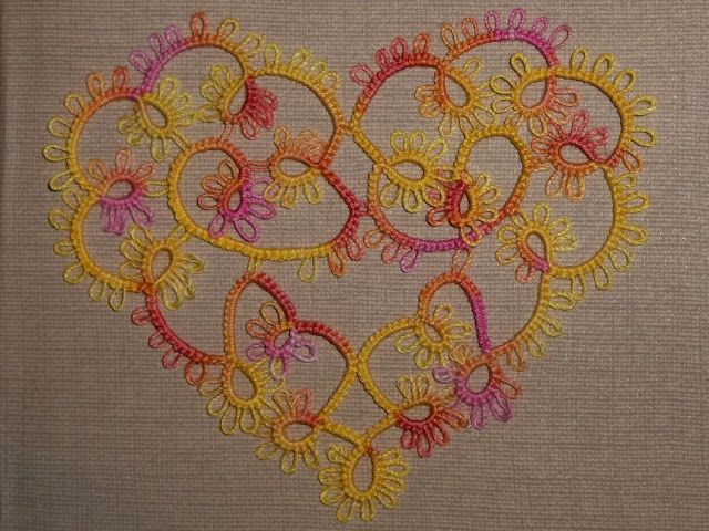 pink and yellow tatted heart