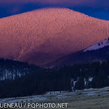Alpenglow is an optical phenomenon created when light reflects off airborne snow, water, or ice particles low in the atmosphere.