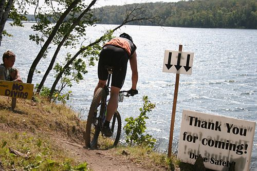 Mountain bike racing at Maplelag and the infamous lakeside drops. Skinnyski.com photo.