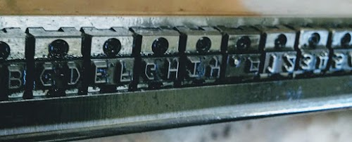 Closeup of the type chain (upside down) for an IBM 1403 line printer.