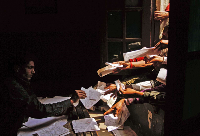 Unemployed Indians handed in paperwork at a government employment office in 2012. Photo: Rajesh Kumar Singh / Associated Press