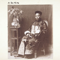 High Quality Chinese Man In The Costume Of A Mandarin Sitting In A Room.