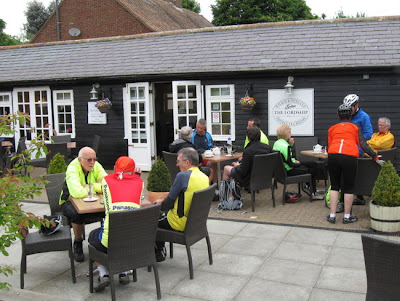 Group having tea outside cafe