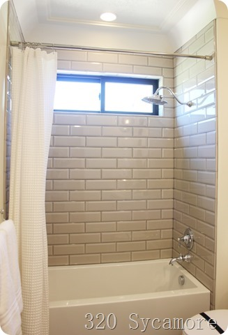 beige subway tile bath