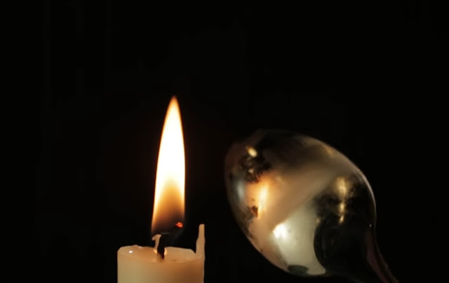 just above to the wick, you've found unburned wax