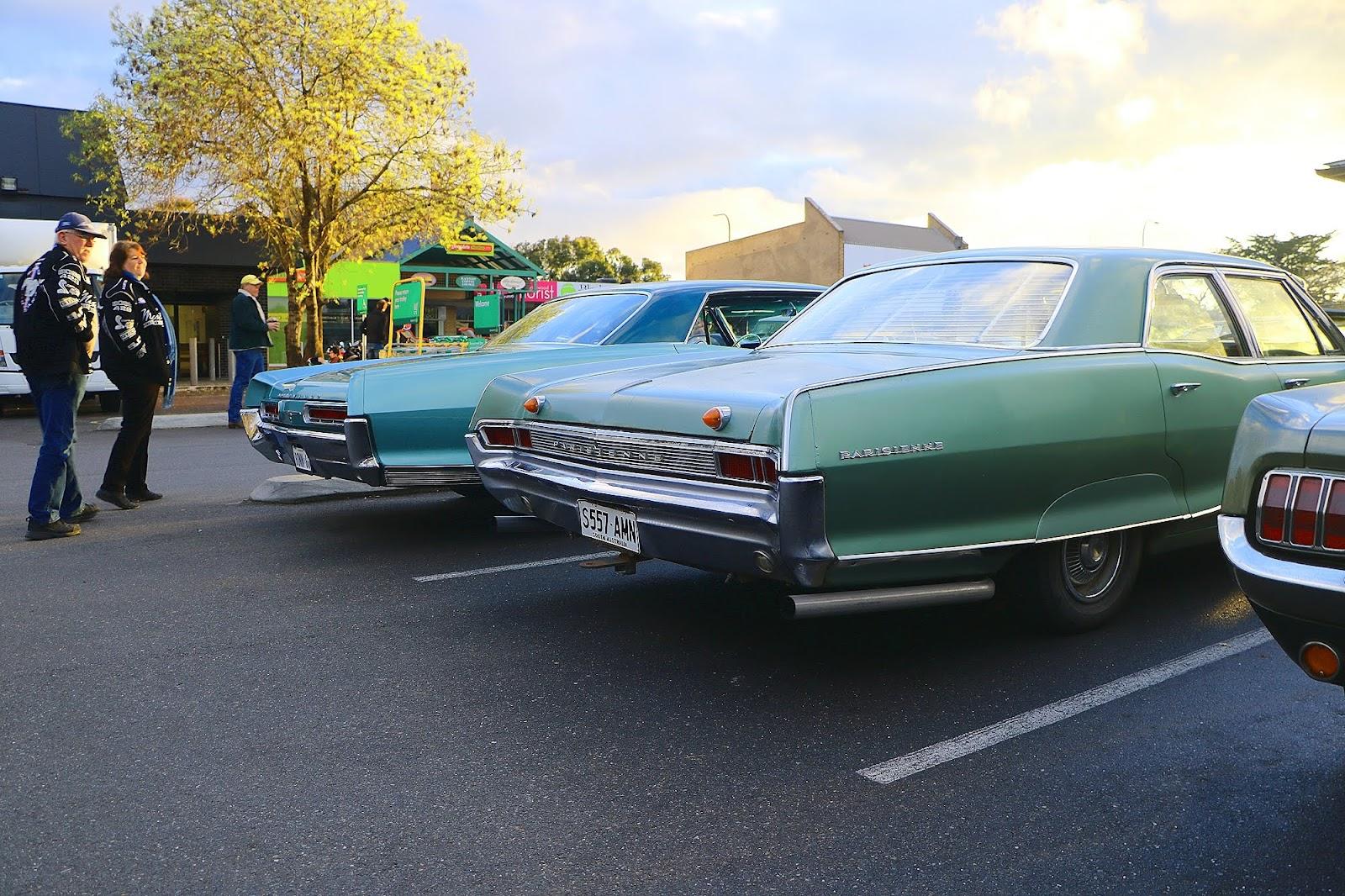 2 Pontiacs - Bonneville and Parisienne.jpg