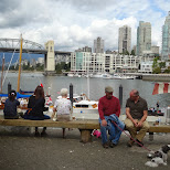 old folks enjoying the view of Granville Island in Vancouver, British Columbia, Canada