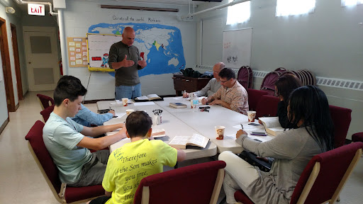 Eric teaching the Church Team important information before the outreach.