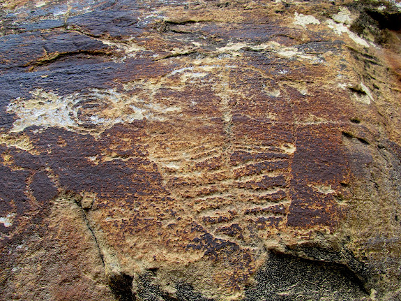 Large, weathered petroglyph