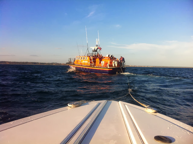 Poole ALB tows a 5.2m speedboat with engine failure 2.5 miles offshore between Bournemouth and Boscombe Piers. 31 August 2013 Photo: RNLI Poole/Dave Riley