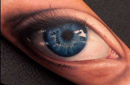realista_olho_azul_antebraço_tatuagem