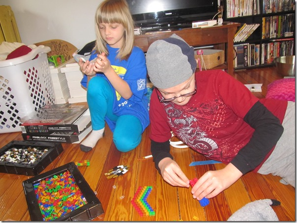 Kids building with Pinblocks 2 at Homeschooling Hearts & Minds