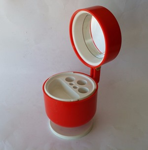 red makeup mirror and stand open